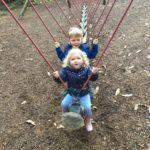 Kids on dragon swing